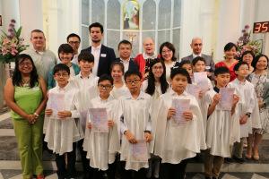 Fr Dennis Hanly w parents and children