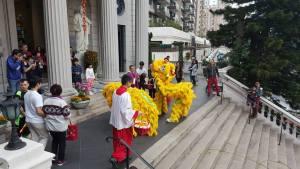 Lion dancers at church steps